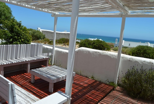 The Self Cater patio - to enjoy the sunshine , fresh air and sea view